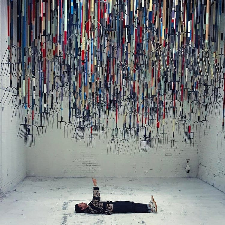 pitchfork installation simon birch 4 - Artist Dares Visitors to Stand Under Pointy Pitchforks Swinging from the Ceiling