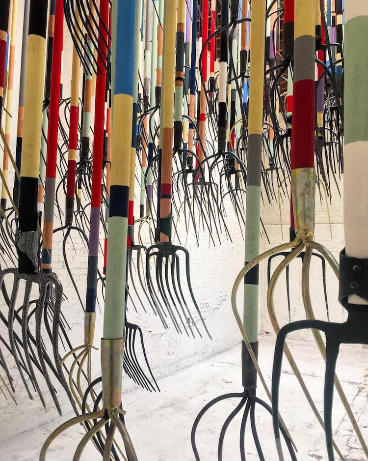 pitchfork installation simon birch 7 - Artist Dares Visitors to Stand Under Pointy Pitchforks Swinging from the Ceiling
