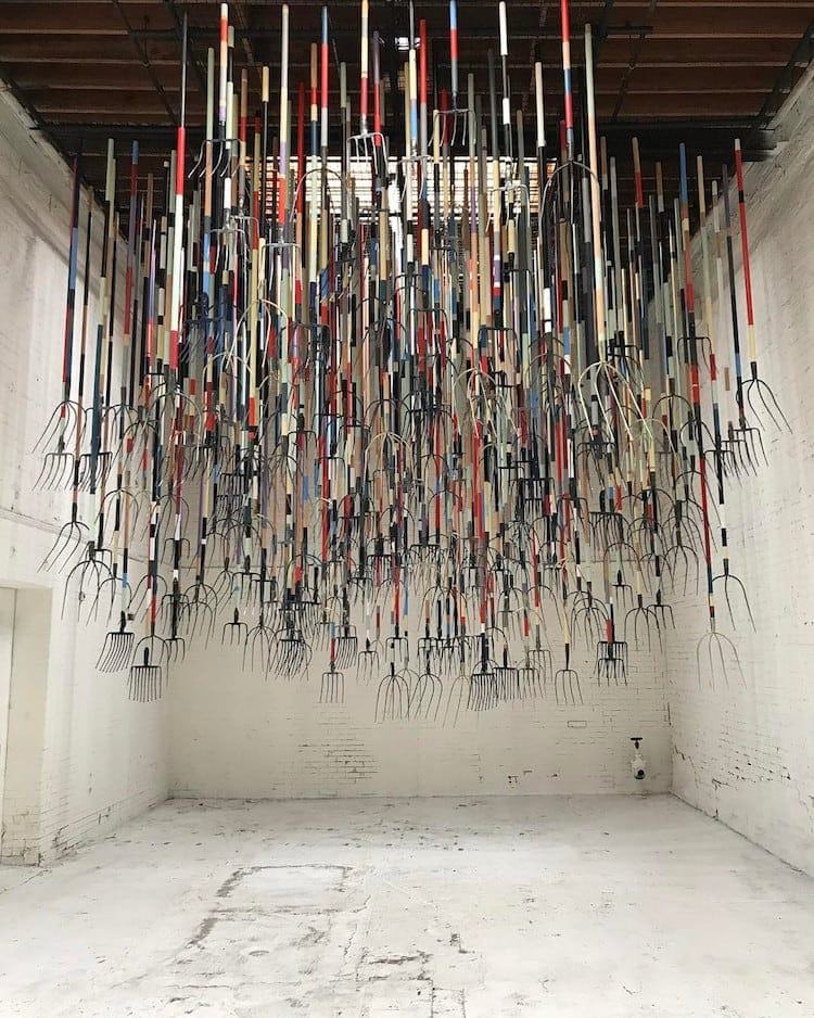 pitchfork installation simon birch 9 - Artist Dares Visitors to Stand Under Pointy Pitchforks Swinging from the Ceiling