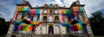 Okuda San Miguel Paints 19th-century Castle with Multi-colored Geometric Skulls -