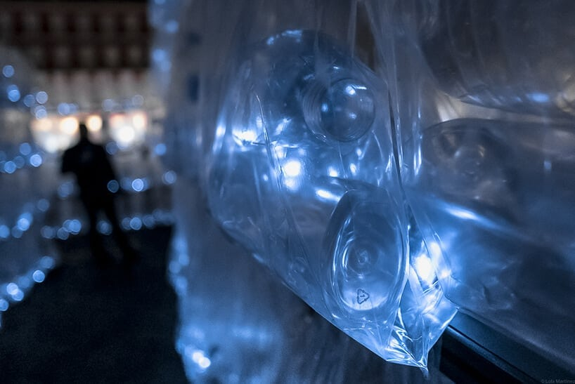 An anonymous art collective installed a glowing labyrinth of plastic waste in Madrid -
