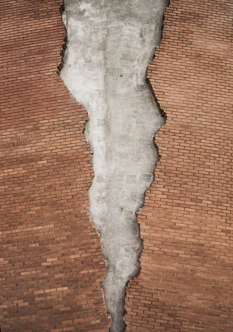 Alex Chinneck Cracks the Front of Brick Building in London -london