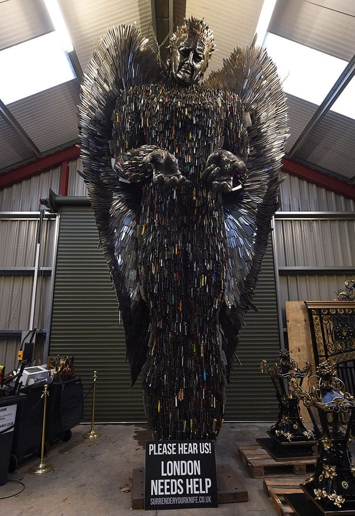 This Huge Angel Sculpture Made Of 100,000 Knives and Guns Is A Persuasive Tribute -sculpture