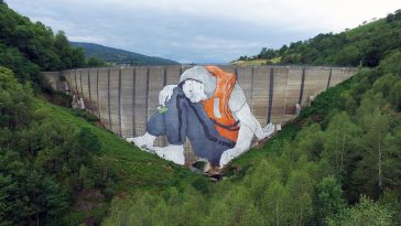 Huge Mural by Ella & Pitr Represents a Refugee Seeking Entrance to France -murals, mural