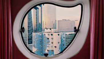 A Photographer Captured Modern Paris Through Retro Porthole Windows of Paris' High-Rise Buildings -urban, landscapes, france, building
