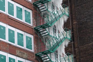 Fire Escape Covered In Ice Due To Top Floor Sprinkler Leak In Chicago -winter, usa, chicago