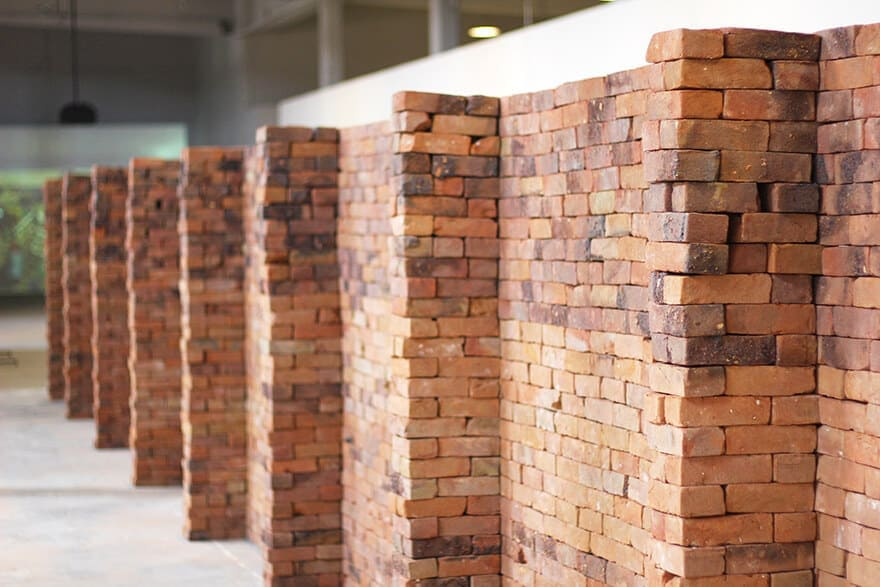 A Mexican Artist Shows The Power Of A Book By Distorting The Base Of A Brick Wall -wall, installation, Franz Kafka